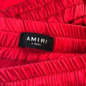 AMIRI red silk jogger pants